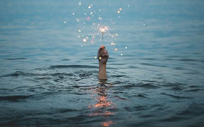 hand out of water holding sparkler