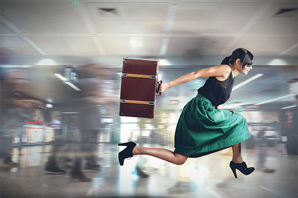 Woman with suitcase in a hurry