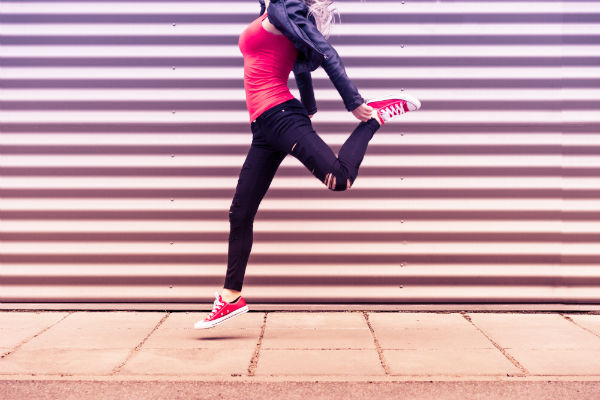 Young happy woman jumping - A metaphor for Optimism is not for everyone Young happy woman