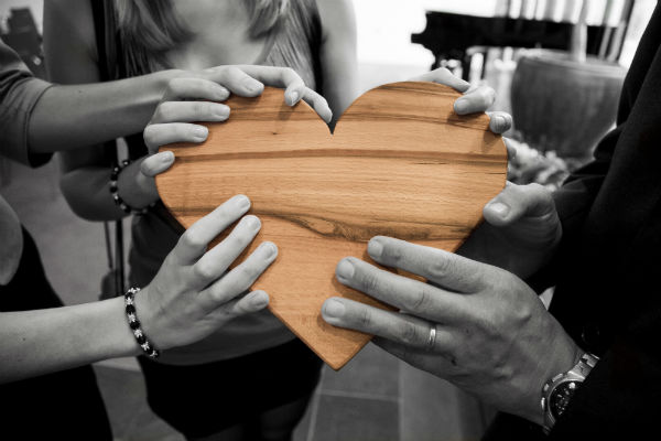 Hands on a wooden heart