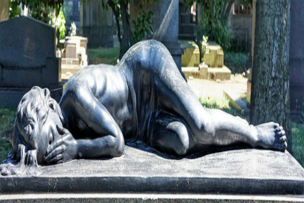grieving sculpture of a lady lying down