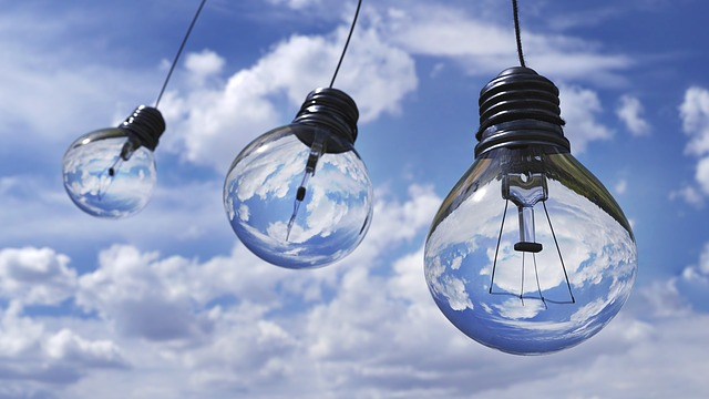 three light bulbs with sky background