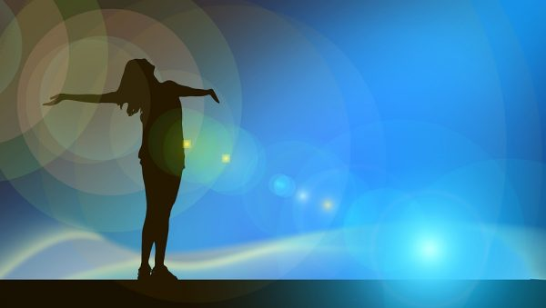 woman standing in sunlight open arms the positive psychology people blog