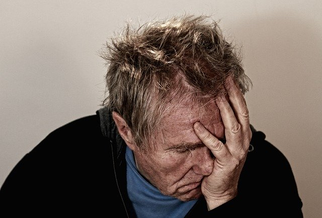 man head in hand in despair blog for the positive psychology people