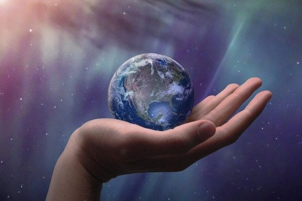 globe held in hand positive psychology blog on meaning