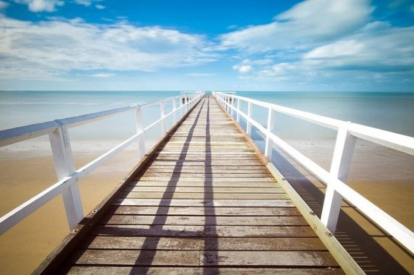 long pier in sunny sky blog about poetry the positive psychology people