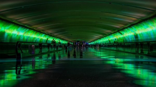 Photo of tunnel with people in green blog for the positive psychology people